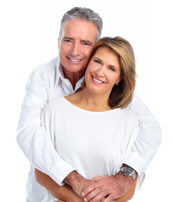 senior couple smiling after dental veneers treatment