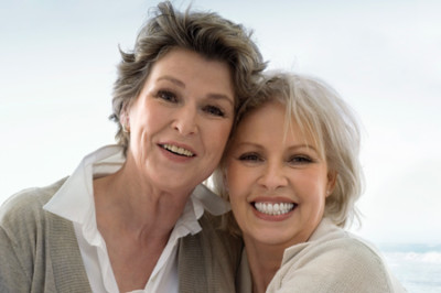 two elderly woman smiling